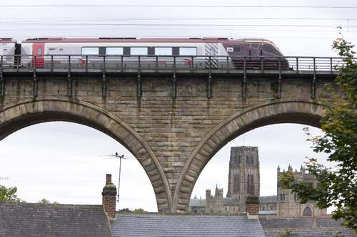 DescriptionLooking through the archways of a viaduct as a train travels across towards Durham Cathedral in County Durham. Durham Cathedral is the greatest Norman building in England, perhaps even in Europe. It is cherished not only for its architecture but also for its incomparable setting. For this reason it was inscribed together with the Castle as one of Britain's first World Heritage Sites., Durham, County Durham, England. Additional Credit: One North East